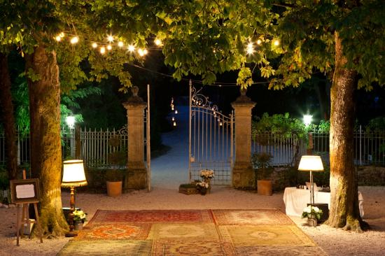 Chateau de Lartigolle : The beautiful courtyard and dancefloor at night