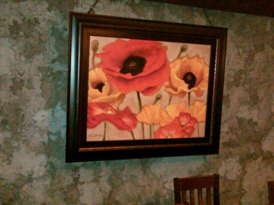 Perennial Vineyards: Bright paintings liven up the cozy dining area along with the wood burning fireplace & table can