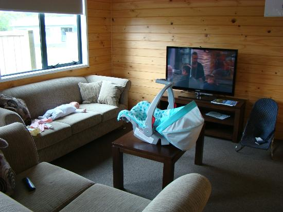 Cooks Beach Resort: Little bubba on the couch in chalet