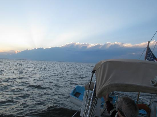 Blue Crab Chesapeake Charters : Afternoon sun, setting behind a cloud bank.