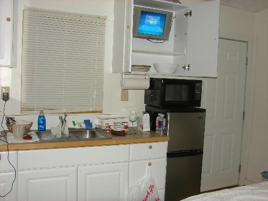 blind squirrel brewery lodge small flat screen tv tucked away in a kitchen cabinet - Small Tv For Kitchen