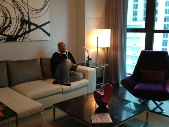 Ivy Boutique Hotel: My husband relaxing in our living area