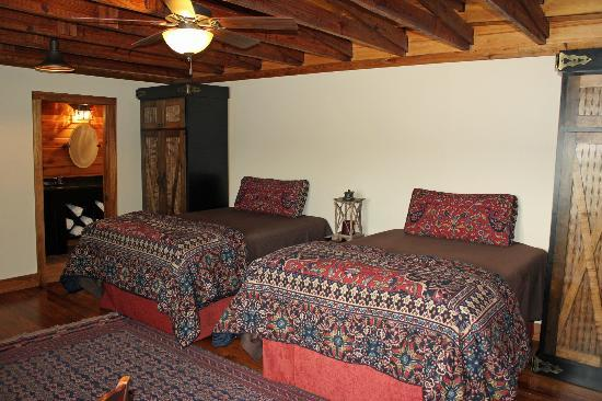 Our Place Hotel: Two full sized beds with memory foam mattresses. All linens are Ralph Lauren & Biltmore Estate.