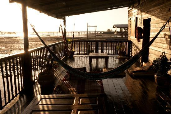 Mango Guesthouse + Villas: Terrace on the water at sunrise (low tide)