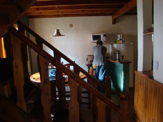 Las Walkirias: Vista desde el living a la cocina comedor del dpto escalera a las hab