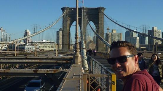 Blazing Saddles Bike Rentals & Tours : Brooklyn Bridge with some happy girls walking by!