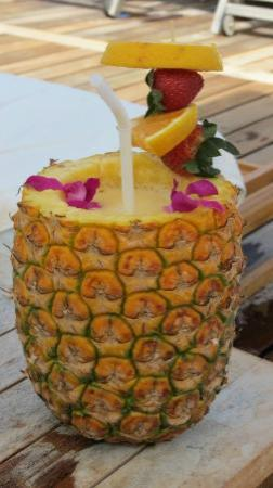 "Four Seasons Resort Hualalai: ""BANGO"", banana and mango smoothie in a pineapple. A must have!"