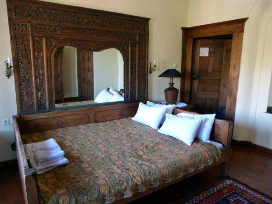 Vergoula's Mansion: our beautiful bed with the mirror