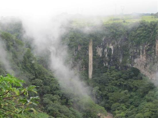 Casa Bella Rita Boutique Bed & Breakfast: Rainy season waterfall across the canyon