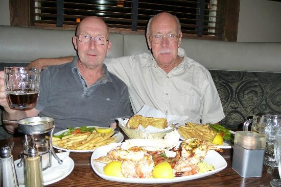 Zala's Steak and Pizza: My husband Allan and Friend Walter enjoying the fish platter