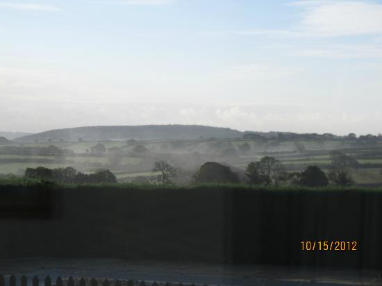 Appledown House Bed and Breakfast: Mist rising in the morning over the fields.