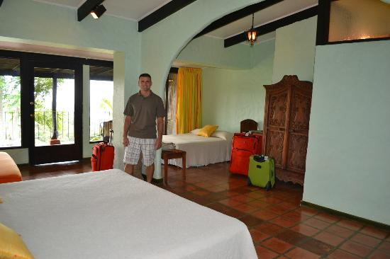 La Mariposa Hotel: Hubby in our first room, room 5... nice & big, but terribly musty!!!