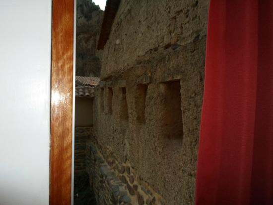 Tikawasi Valley Hotel: Inca wall located outside of room 210