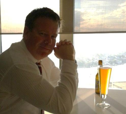 Shangri-La Hotel Sydney: My partner enjoying the view and a cold beer. He deserved it having booked this place for our a