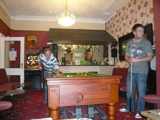 Manchester House: the men playing pool in the hotel