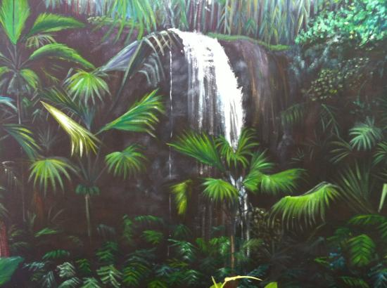 Villa Bananier: Sitting room mural depicting waterfall in Vallee de Mai