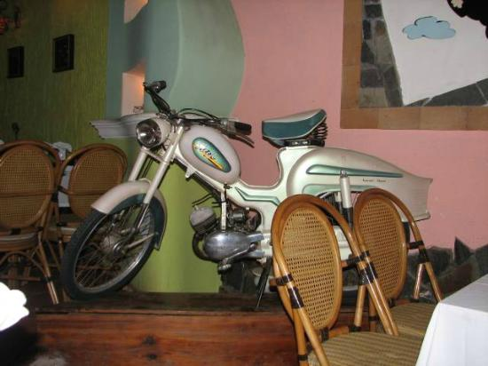 de Famille: Not a lot of restaurants have motor bikes in them!