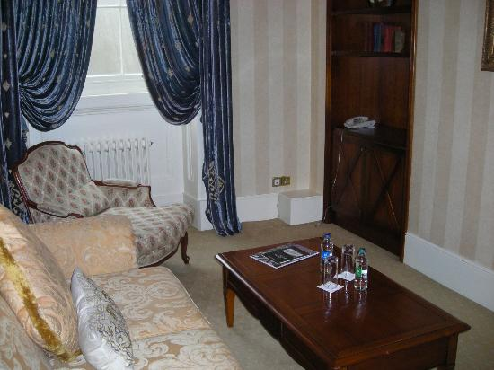 Hotel Meyrick: our sitting room-note the heavy drapes and overstuffed furniture