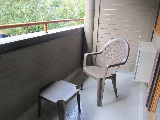 Whistler Village Inn + Suites: 2 chairs and a table on our balcony