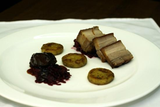 Palazzo Restaurant: Slow roasted pork belly with braised pork cheek, pickled red cabbage and oregano potato dumpling