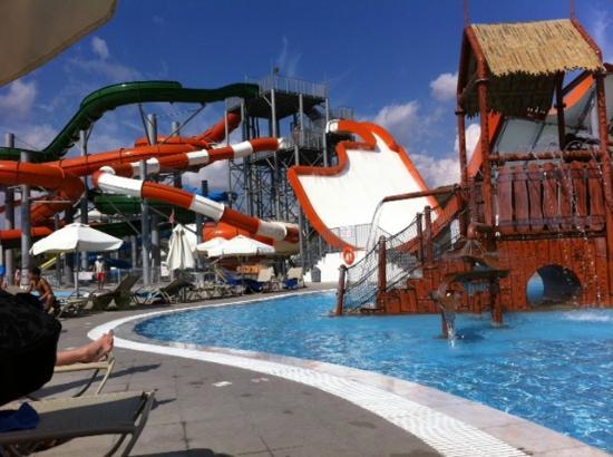 Adult slides in the backgrouund (cant see them all) - Picture of Sun Palace Hotel, Faliraki ...