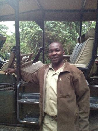 andBeyond Kichwa Tembo Tented Camp: Akatch, our guide, with his open jeep