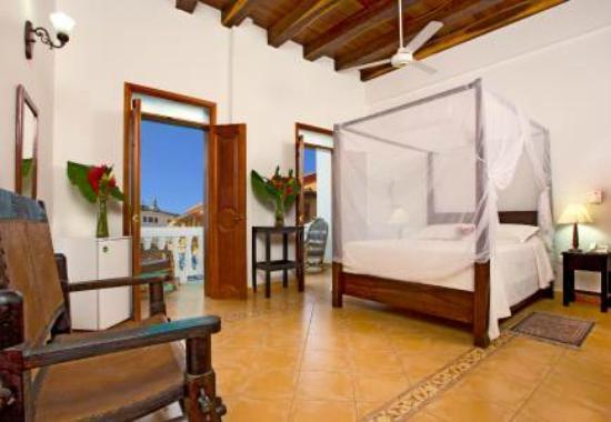 Hotel Casa del Curato: hab. suite con balcon a la piscina