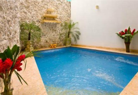 Hotel Casa del Curato: piscina y zona recreativa