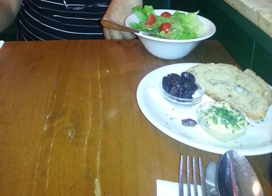 Topoleone Trattoria: Appetizer - bread with black olives and mustard mayonnaise sauce 1
