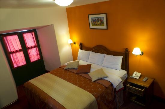 Amerinka Boutique Hotel: habitacion matrimonial con cama super queen