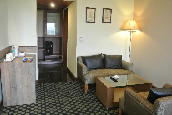 Quality Inn Bliss: The sofa set, wardrobe and entrance.
