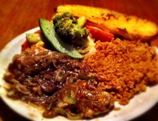 Casa Nostra: Snook-fish filet with special sauce, veggies, and rice