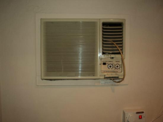 Sun Aviv Hotel: Old A/C unit stuck in the wall but non-functioning