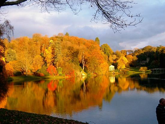 Stourhead House and Garden: The Autumn sun brings out the colours of the trees