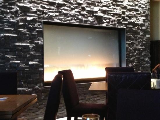Toasted Oak Grill & Market : beautiful fireplace wall