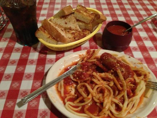 Dino's Italian Food: House-made noodles with sausage, garlic toast basket and an extra side of sauce.