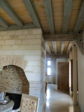 La Maison de Rhodes: Long view of our room, petit louvre, from fireplace to the window at the faraway bedroom.