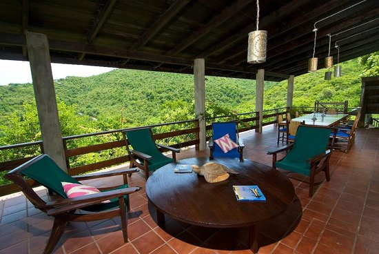 Guests Enjoy Drinks on the Veranda at French House, Sugar Reef Bequia