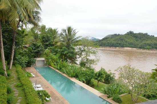 Mekong Estate : View of the pool and river from the upstairs bedroom