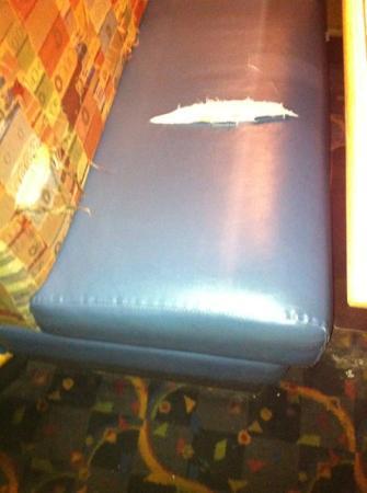 Boston Pizza: Damaged seat.