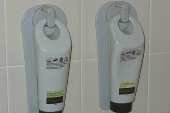 Inn of Naples: Interesting amenity, shampoo and conditioner attached to shower wall.