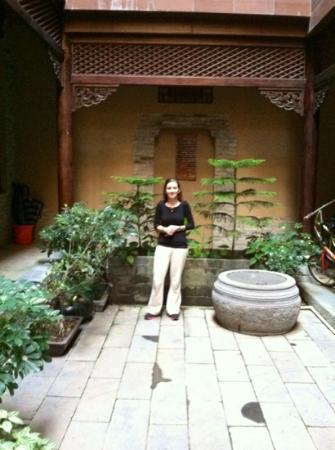 Hidden Dragon Villa: my wife in the courtyard