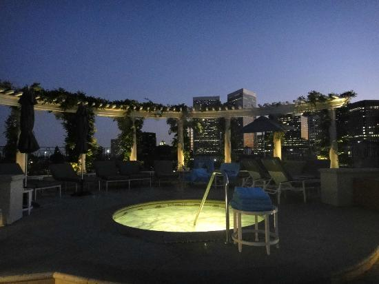 The Peninsula Beverly Hills: rooftop pool with jacuzzi at night