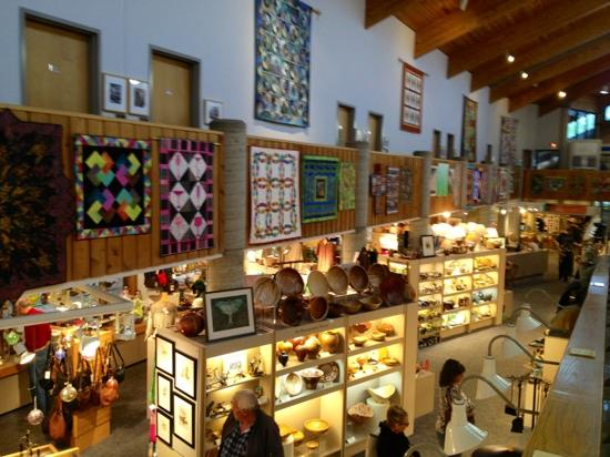 Southern Highland Craft Guild Folk Art Center: art quilts hanging above the very large and diverse gift shop