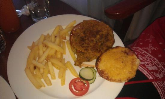 Hotel White Sands, Resort & Conference Centre: Veggie burger - more of a stew (over spiced) on bread. 'salad' =1 slice tomato, 2 slices cucumbe