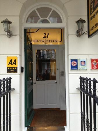 The Twenty One: Entrance door with awards