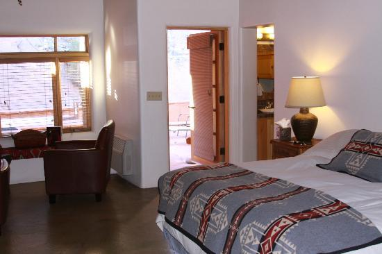 Ojo Caliente Mineral Springs Resort and Spa: Patio door to private soaking area facing hills.