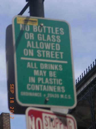 Bourbon Street: Sign saying how you can drink while walking though the French Quarter.