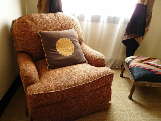 "Holland Hotel: A chair in the ""living room"" of our suite"