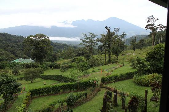 Celeste Mountain Lodge : French Garden and cloud covered Mnt. Arenal